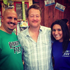 <p>Actor Christian Stolte of the TV show Chicago Fire visited Rocket Fizz in Glenview Illinois. Rocket Fizz franchisees Robert and Amber are with him.</p>