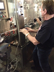 <p>Rowdy Roddy Piper watching his bubble gum soda being bottled at the Rocket Fizz bottling plant in Northern California.</p>