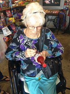 "<p>Grandma Melba of the Rocket Fizz bottled soda line ""Melba's Fixins"" is autographing a bottle of her Strawberries & Cream soda pop at Rocket Fizz Camarillo... Sometimes it's very hard to get Melba out of her kitchen because she loves to bake pies and make cakes all of the time.</p>"