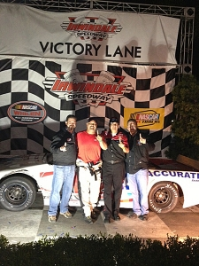 <p>Rocket Fizz won first place in the Whelen All-American NASCAR race truck division for the 2013 racing season. In this picture, Rocket Ryan and Rocket Rob are with Rocket Fizz NASCAR race driver Darren and race team manager Rob.</p>