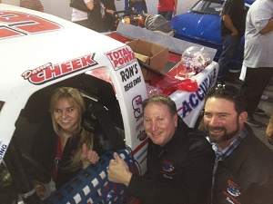<p>Katie sitting in our Rocket Fizz NASCAR race truck. She and her Dad won the Rocket Fizz showcase on the Father's Day episode of The Price Is Right TV show.</p>