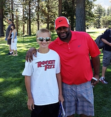 <p>Rocket Fizz South Lake Tahoe family member Ty standing with former NFL star running back Jerome Bettis (aka 'The Bus')... Imagine all of the records Jerome would have broken had he guzzled a bottle of our Rocket Fuel energy drink before each game.</p>