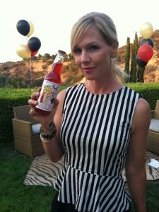 <p>Jennie Garth (Beverly Hills 90210, etc.) holding her daughter Luca Bella's Sweet-16 Rocket Fizz bottled custom soda.</p>