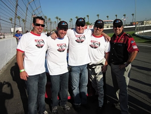 <p>Co-founders Robert and Ryan joined by friends on the track with the Rocket Fizz sponsored NASCAR racecar.</p>