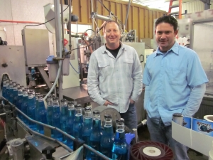 <p>Rob and Ryan at a Rocket Fizz bottling plant</p>