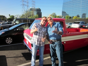 <p>Rocket Rob and Jay Leno goofing off next to Jay's 1961 Chevy Corvair.</p>