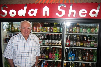 <p>The very first judge on national television, Judge Joseph A. Wapner of the People's Court TV show. In this photo, Judge Wapner is standing next to his 'Judge Wapner Root Beer' at the Camarillo, California Rocket Fizz store.</p>