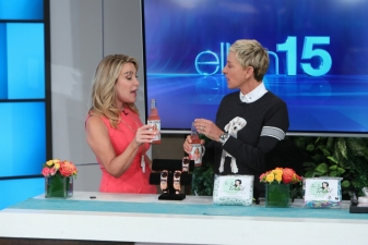 """<p>Lifestyle expert Kym Douglas on The Ellen Show. Kym and Ellen are talking about Kym's Rocket Fizz bottled """"Glamorous Grapefruit"""" soda pop. Kym was messing around with her eyebrow just prior to this scene.</p>"""